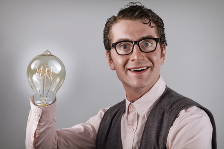 snazzy: Nerdy four eyed businessman is happy about his new idea