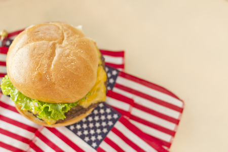 Patriotic American flag cheeseburger for American patriotism celebration food image