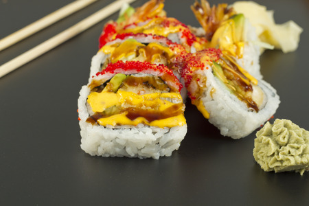 Beautiful fresh shrimp tempura sushi roll with tobiko and spicy mayonnaise