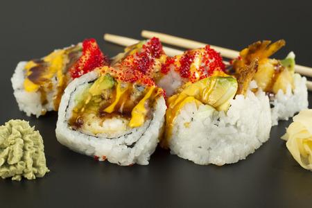 Beautiful fresh shrimp tempura sushi roll with tobiko and spicy mayonnaise