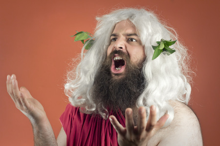 mouthing: Pleading zeus god or jupiter throws his hands in the air Stock Photo