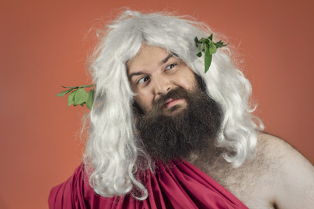 disgusted: Disgusted Zeus or Jupiter the mythological god against orange background Stock Photo
