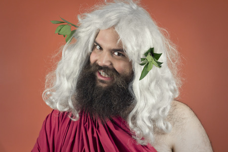 grinning: Grinning Zeus god or jupiter looks menacing against orange background