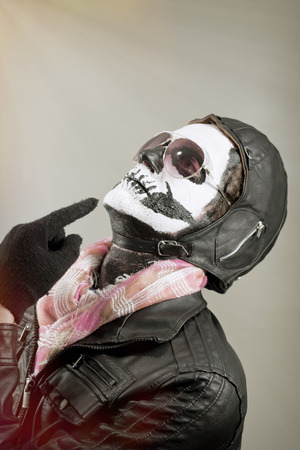 enlightening: Enlightening aviator with face painted as human skull