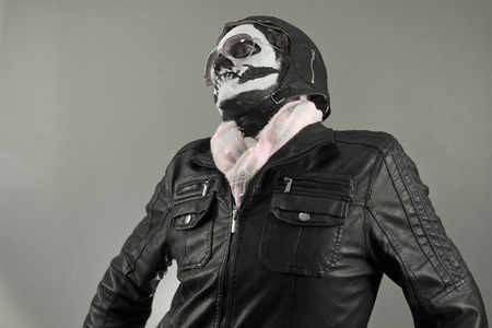 Egocentric aviator with face painted as human skull Stock Photo