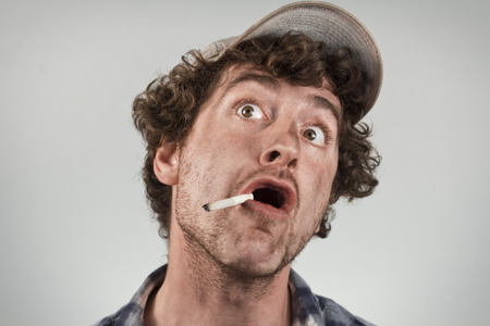 blown away: Amazed redneck has just had his mind blown as he smokes a cigarette