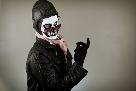 to beckon: Beckoning aviator with face painted as human skull