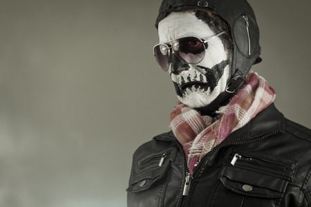 disgusted: Disgusted aviator with face painted as human skull
