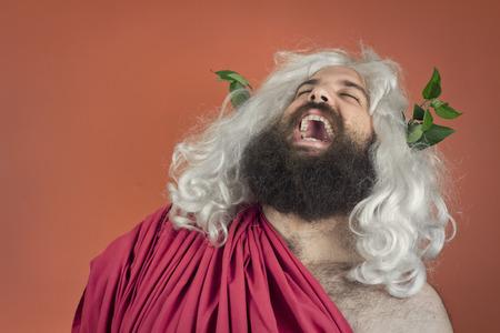 Laughing zeus god or jupiter against orange background Standard-Bild