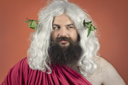 disapproving: Disapprovazione dio Zeus o Giove contro sfondo arancione Archivio Fotografico