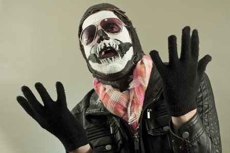 pleading: Pleading aviator with face painted as human skull