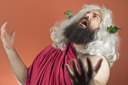 disapproving: Pleading zeus god or jupiter throws his hands in the air Stock Photo