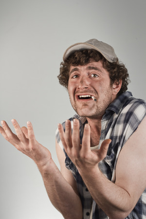 mouthing: Pleading redneck throws his arms in the air in confusion and disgust