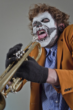trumpet player: Angry trumpet player with face painted as human skull