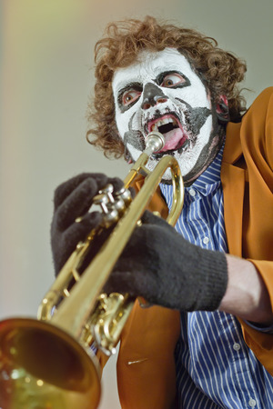 making music: Professional trumpet player with face painted as human skull Stock Photo