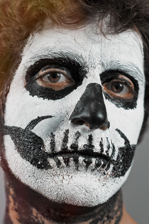 face paint: Close up portrait of man with halloween skull face paint