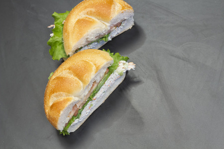 bound: Bound seafood salad sandwich with mayo on a kaiser roll