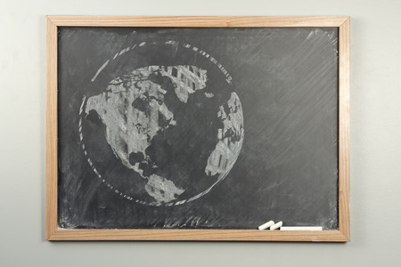 black grunge background: Chalkboard sketch drawing map of the world for education concept