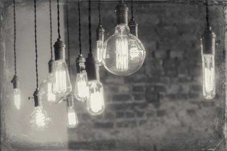 filament: Decorative antique edison style filament light bulbs against brick wall