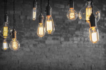Decorative antique edison style filament light bulbs against brick wall