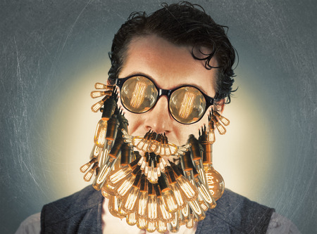 bearded wires: Classy stylish man with lightbulb beard and glasses Stock Photo