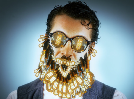 bearded wire: Classy stylish man with lightbulb beard and glasses Stock Photo