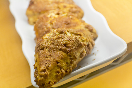 display case: French triangle puff pastry with cinnamon crumbles in display case
