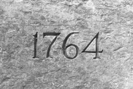 Granite wall with the year 1764 etched in stone Banco de Imagens