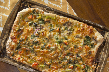 pizza pie: Home made artisan veggie pizza pie with onions peppers spinach and olives