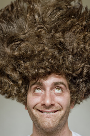 messy: Scruffy faced man with messy curly hair afro Stock Photo