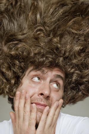 Scruffy faced man with messy curly hair afro Stock Photo