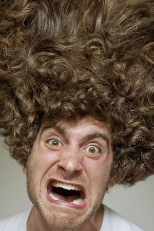 scruffy: Scruffy faced man with messy curly hair afro Stock Photo