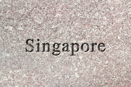 chiseled: Engraving spelling the city Singapore on textured old surface Stock Photo