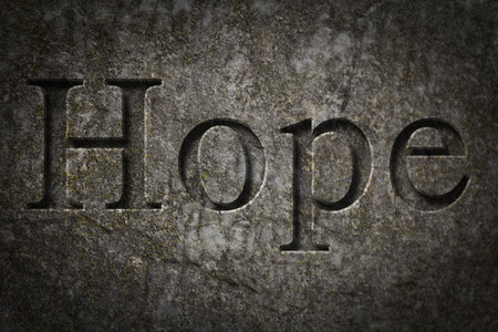 hope: Engraving spelling the word Hope on textured old surface