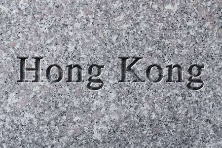 Engraving spelling the city Hong Kongon textured old surface Reklamní fotografie
