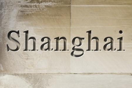 Engraving spelling the city Shanghai on textured old surface Reklamní fotografie