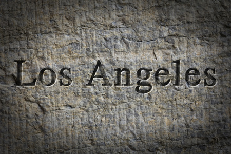 Engraving spelling the city Los Angeles on textured old surface