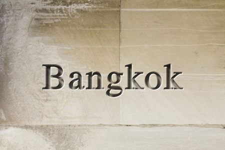 etch: Engraving spelling the city Bangkok on textured old surface