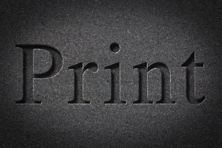 chiseled: Engraving spelling the word Print on textured old surface