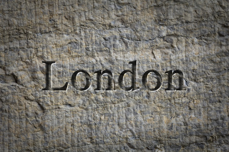 etch: Engraving spelling the city London on textured old surface