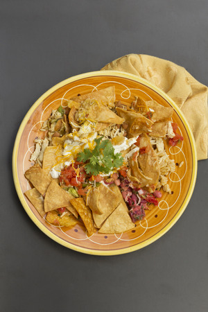 cilantro: Authentic Mexican nachos with sour cream jalapeno and cilantro