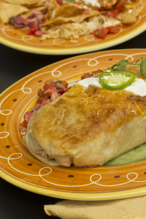 cilantro: Authentic Mexican burrito with sour cream jalapeno and cilantro