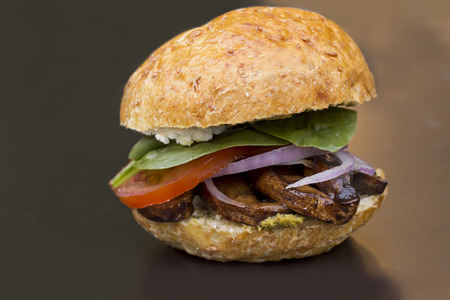 vegetarian hamburger: Portobello mushroom sandwich with goat cheese and pesto
