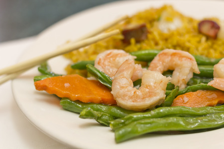 Chinese savory garlic shrimp with string beans and pork fried rice Stock Photo