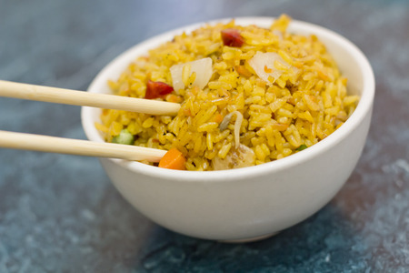 selective focus: Selective focus on bowl of yellow Chinese pork fried rice