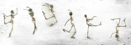 Silly dancing medical skeletons on grunge vintage background