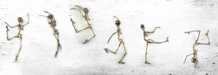 skeleton: Silly dancing medical skeletons on grunge vintage background