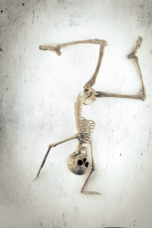 hip joint: Silly dancing medical skeleton on grunge vintage background Stock Photo