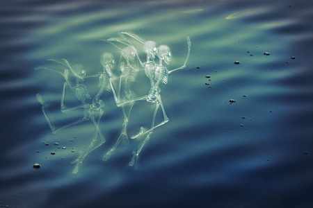 sirens: Scary dancing fairy skeletons on water background Stock Photo