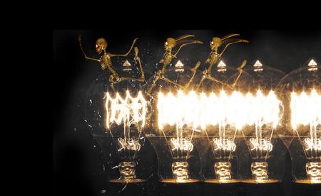 horrifying: Horrifying vintage Halloween themed skeletons run along lightbulbs